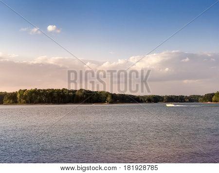 speed boat riding during sunset on Lake Lanier in Cumming Georgia