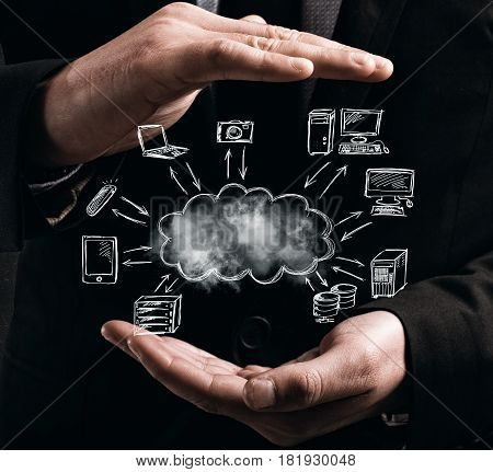 Man holds in his hands a cloud. Virtual cloud network concept