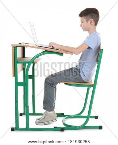 Incorrect posture concept. Schoolboy sitting at desk on white background