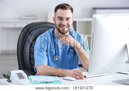 Young medical assistant working in office