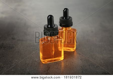 Bottles with perfume oil on grunge background