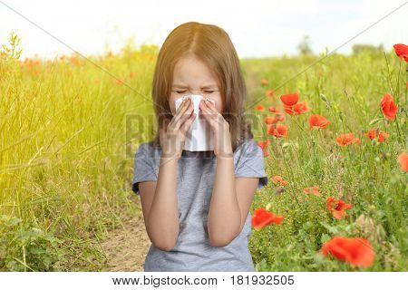 Seasonal allergy. Little girl with tissue outdoor