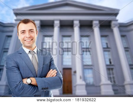 Law and justice concept. Young man on courthouse background