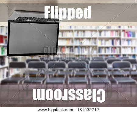 Flipped classroom concept. Inversed laptop on library background