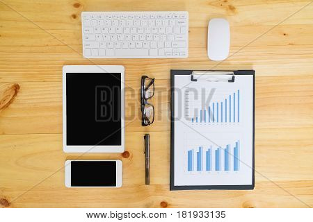 Office Desk Table With Computer, Supplies, Analysis Chart, Calculator, Pen And Glasses .
