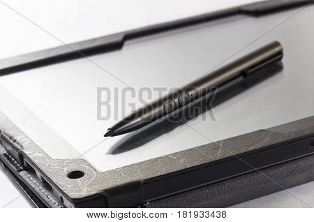 The stylus lies on the screen of the tablet