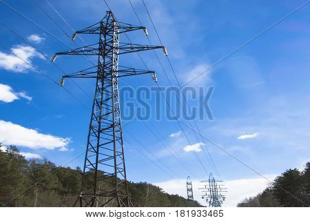Power line against the blue sky .