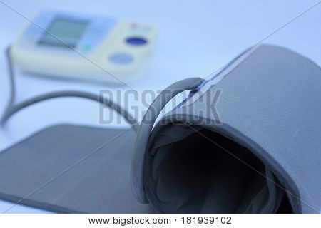 a blood pressure monitor on white background