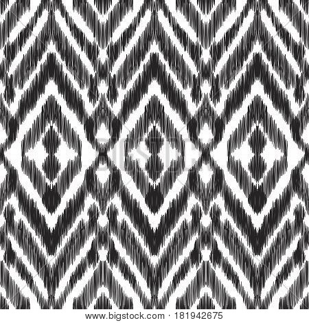 Vector illustration of the black and white colored ikat ornamental seamless pattern. Chevron design. Scribble textured effect.