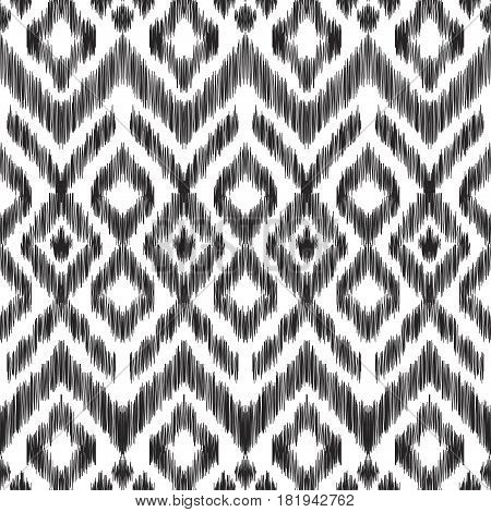 Vector illustration of the black and white colored ikat ornamental seamless pattern. Chevron design. Scribble textured effect. Ethnic style.