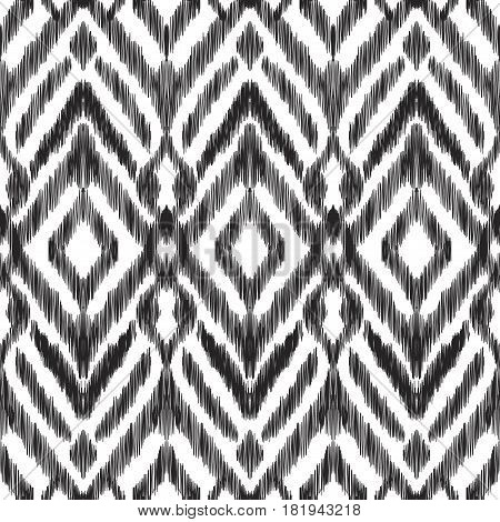Vector illustration of the black and white colored ikat ornamental seamless pattern. Chevron design.