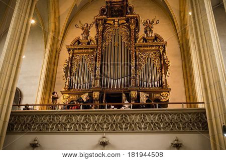 Neuoetting,Germany-April 16,2017: The church choir rehearses one last time before Easter Sunday mass begins