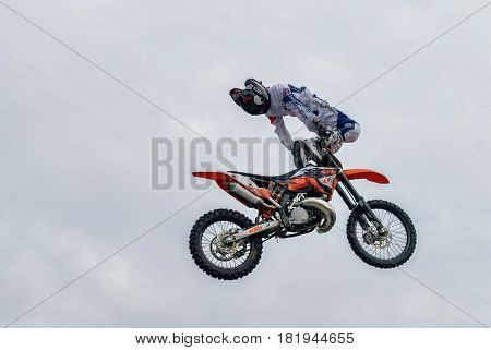 Tyumen, Russia - June 10, 2009: Stunt rider from the X-fighter team pulls a one handed air stunt for the watching public