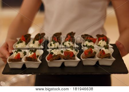 appetizer of feta, fresh tomatoes, greens with croutons