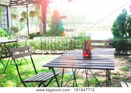 Home garden with wooden table and chairs