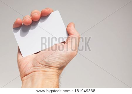 Male Hand Holds White Empty Card