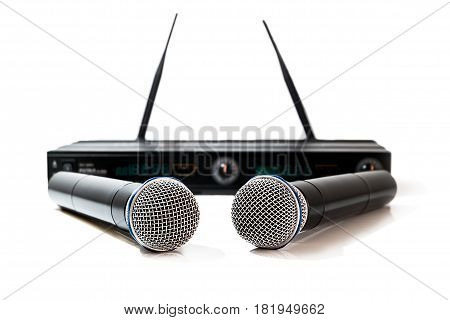 Microphone isolated on white background Two microphone system on white background.