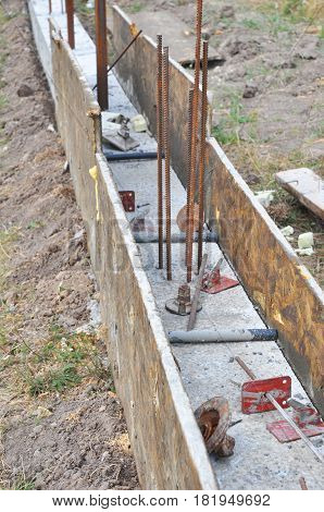 Concrete Foundation for Fencing. Foundation with wooden slabs.