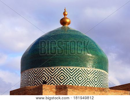 Dome of a central asian mosque on the bacground of sky