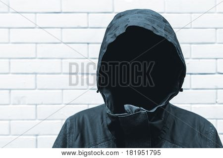 Protected witness identity concept with faceless hooded person