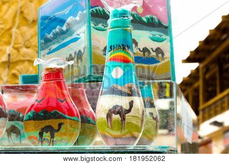 Decorative Glass Bottles with Colored Sand Inside and Shapes of Desert and Camels. The Symbol of the Sharm El Sheikh
