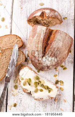 Fresh bread. Homemade traditional bread. Sliced bread crumbs knife and butter