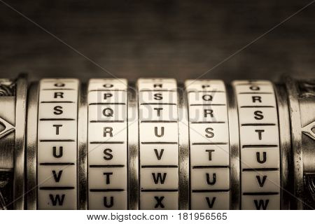 trust word as a password to combination puzzle box with rings of letters, black and white platinum toned image