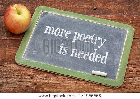 more poetry is needed-  words on a slate blackboard against red barn wood
