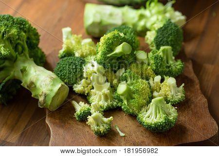 Healthy Green Organic Raw Broccoli Florets Ready For Cooking. Broccoli.raw Fresh Broccoli On Wooden