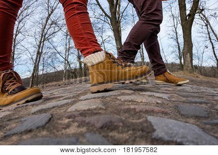 Two Walk In Shoes Along The Pavement. Walk In The Fresh Air