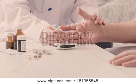 the women  doctor measuring blood sugar  indoor