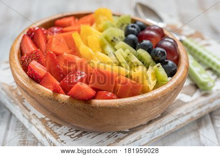 Healthy eating breakfast oatmeal for kids topped with rainbow fruits