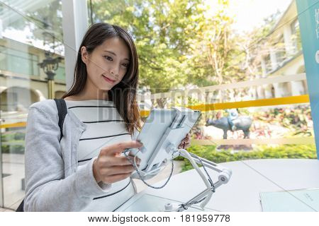 Woman using digital tablet to find information