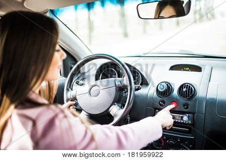Woman With Hand Pressing Emergency Light Button On Car Dashboard.