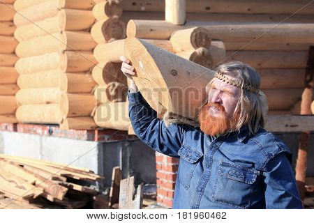 Portrait Of A Man With A Log In His Hands