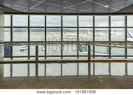 View From Modern New Departure Hall With Window To Apron