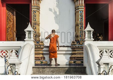 Monk In The Temple Wat Thewarat At The River Mae Nam Chao Phraya In Bangkok