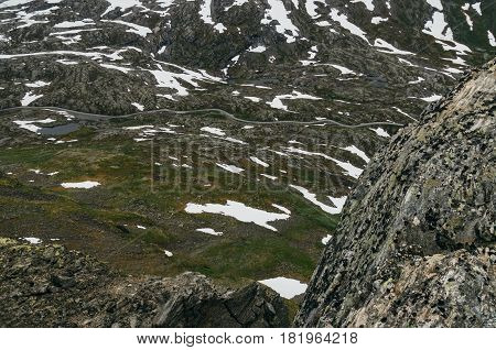 Road through lifeless tundra landscape elevated view