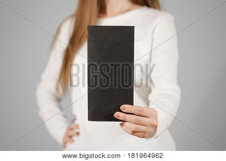 Girl Showing Blank Black Flyer Brochure Booklet. Leaflet Presentation. Pamphlet Hold Hands. Woman Sh