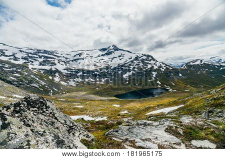 Secluded highland lake between scandinavian mountains Norway
