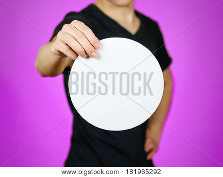 Man Showing Blank White Rounded Flyer Brochure Booklet. Leaflet Presentation. Pamphlet Hold Hands. M