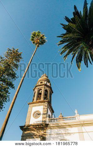 Belfry of Cathedral of San Cristobal de La Laguna against blue sky Tenerife Spain