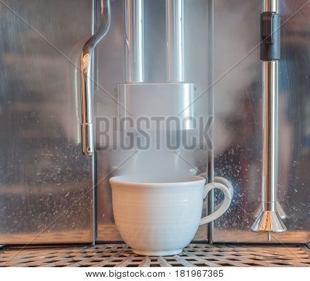 Boiling water and steaming process of coffee machines in coffee shop.