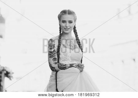 Close Up Portrait Of Beautiful Bride With Tattoo And Long Hair In Braids. Girl Dressed In A Classic