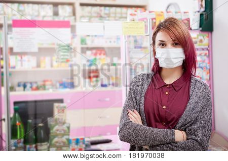 Client in a mask in front of the pharmacy desk. Healthcare business