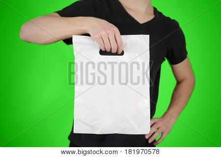 Man Shows Blank Plastic Bag Mock Up Isolated. Empty White Polyethylene Package Mockup. Consumer Pack