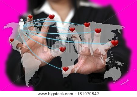 Woman Hand Find Love Around the World using in Love Valentine Holiday Concept (Selective focus at Finger)