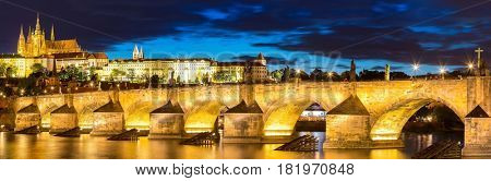 Pargue sunset, view of the Lesser Bridge Tower of Charles Bridge (Karluv Most) and Prague Castle, Czech Republic.