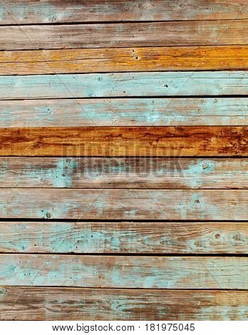 Texture of ancient wood with cracked paint of blue color