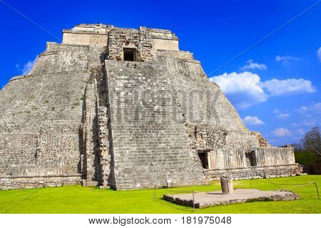 Ancient Mayan pyramid of the Magician in Uxmal with god Chaac masks (god of rain), Yucatan, Mexico. UNESCO world heritage site